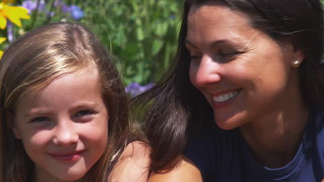 slo mo cu portrait of mother and daughter (12-13) smiling to camera / utah, usa - 12 13 år bildbanksvideor och videomaterial från bakom kulisserna