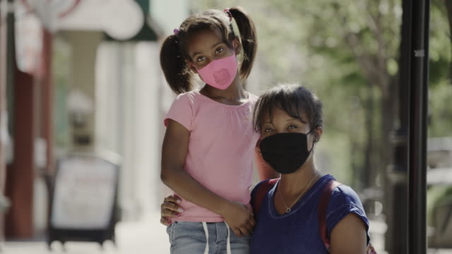 portrait of mother and daughter wearing protective masks posing in city / provo, utah, united states - provo stock videos & royalty-free footage