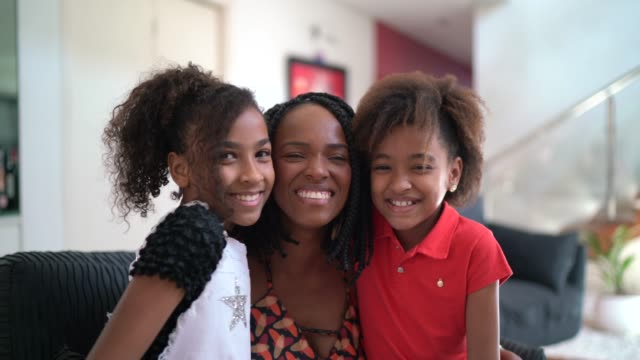 portrait of mother and daughters at home - family with two children stock videos & royalty-free footage