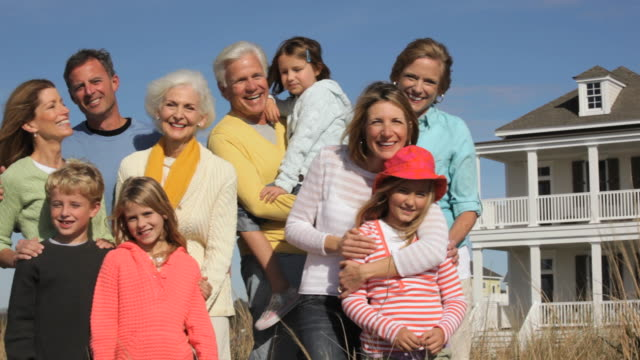 ws pan portrait of multi generational family in front of beach house / eastville, virginia, usa - beach house stock videos & royalty-free footage