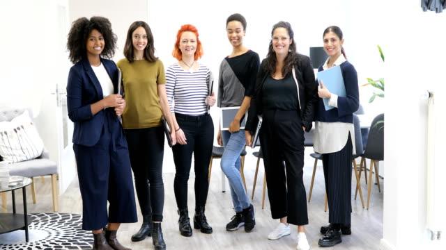 portrait of multi-ethnic smiling businesswomen - girl power stock videos & royalty-free footage