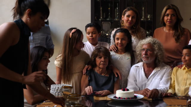 r/f ms portrait of multigenerational family gathered at dining room table for birthday dinner - table stock videos & royalty-free footage