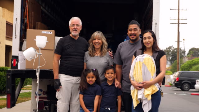 ms portrait of multigenerational family standing at back of moving truck during move - grandson stock videos & royalty-free footage