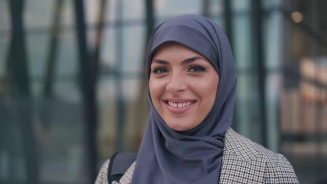 portrait of muslim businesswoman - smiling stock videos & royalty-free footage