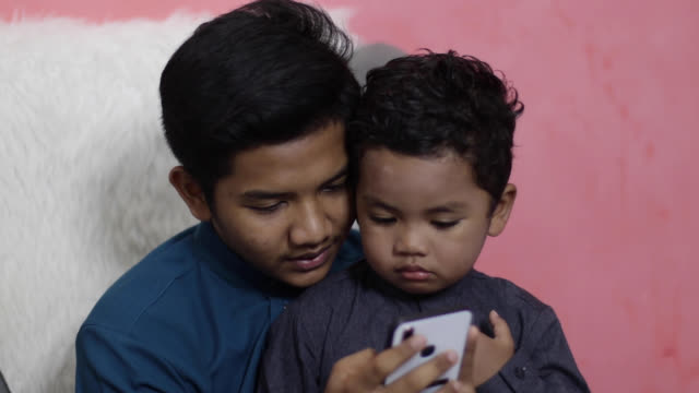 portrait of muslim family in malaysia - brother stock videos & royalty-free footage