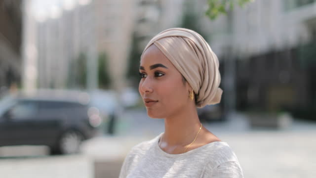 portrait of muslim woman on city street - middle eastern culture stock videos & royalty-free footage