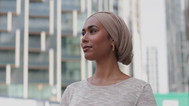 portrait of muslim woman on city street - hijab stock videos & royalty-free footage