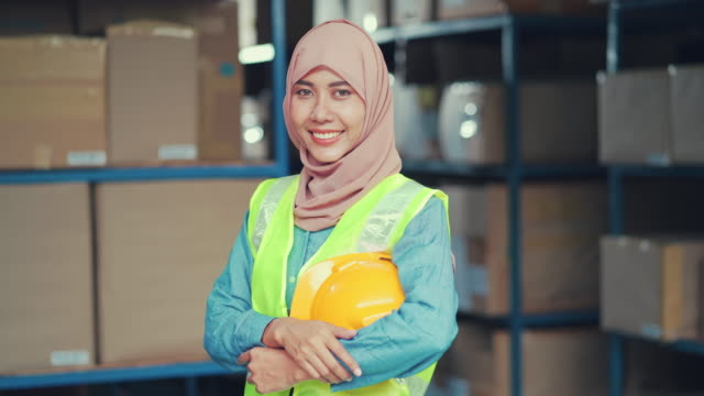 portrait of muslim worker smiling in warehouse - thailand stock videos & royalty-free footage