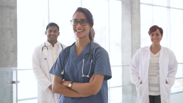 portrait of muti-ethnic doctors - hijab stock videos & royalty-free footage