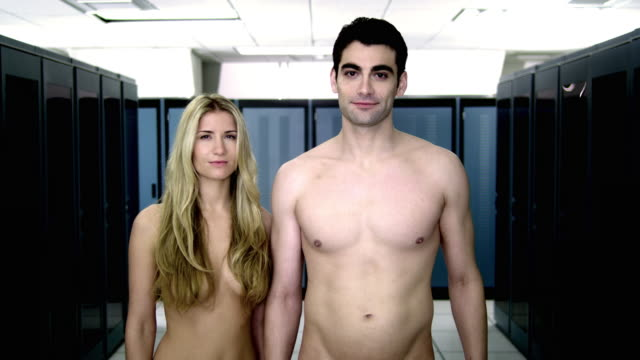 ms portrait of naked young couple standing in server room - naked stock videos and b-roll footage