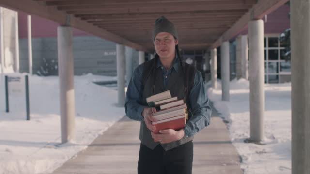 portrait of native american college student with books - nordamerikansk indiankultur bildbanksvideor och videomaterial från bakom kulisserna
