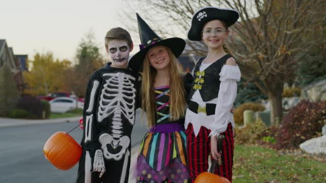 portrait of neighborhood children wearing halloween costumes / cedar hills, utah, united states - fancy dress costume stock videos and b-roll footage
