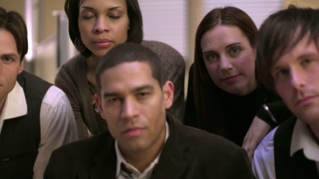 cu pan portrait of office workers posing in office, appleton, wisconsin, usa - appleton video stock e b–roll