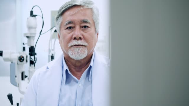 Portrait of older man at ophthalmological examination in consulting room