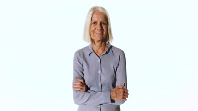 portrait of older woman talking on cell phone - white background stock videos & royalty-free footage