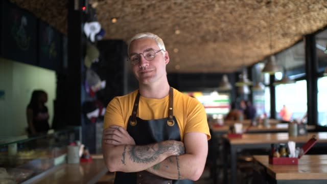 portrait of owner / waiter at restaurant - hipster culture stock videos & royalty-free footage