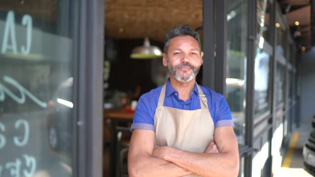 portrait of owner / waiter at restaurant - apron stock videos & royalty-free footage