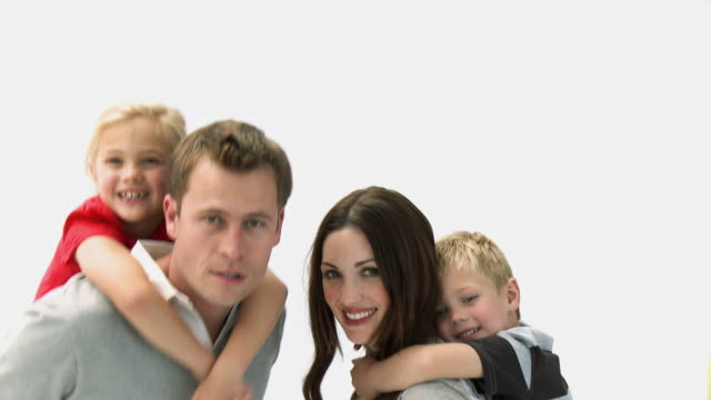 ms portrait of parents giving daughter (8-9) and son (4-5) piggyback ride in studio / cape town, western cape, south africa - piggyback stock videos and b-roll footage