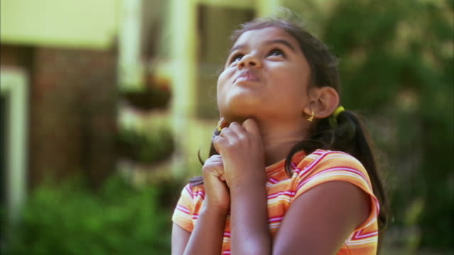 cu portrait of pensive girl (6-7) in garden, halifax, nova scotia, canada - elementary age stock videos & royalty-free footage