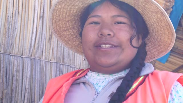 portrait of peruvian woman in uros floating island, lake titicaca, peru - indigenous culture stock videos & royalty-free footage