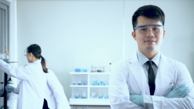 portrait of profressional scientist lab officer while team scientist - microbiologia video stock e b–roll