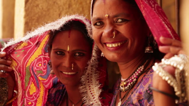 portrait of rajasthani women smiling, jaisalmer, rajasthan, india - 先住民文化点の映像素材/bロール