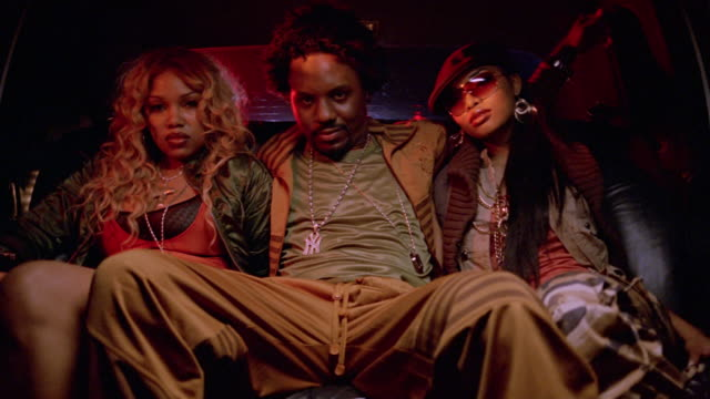 stockvideo's en b-roll-footage met portrait of rapper and two women in limo / women leaning forward on man's chest - filipijnse etniciteit