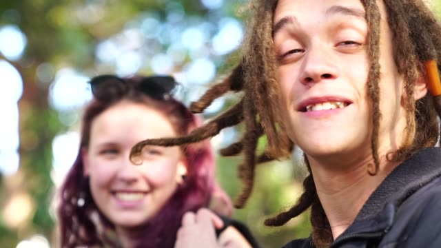 Portrait of Rastafarian Young Man and Girl on Background