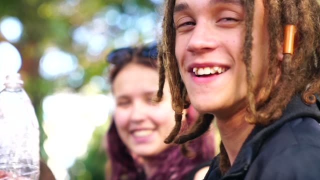 portrait of rastafarian young man and girl on background - dreadlocks stock videos & royalty-free footage