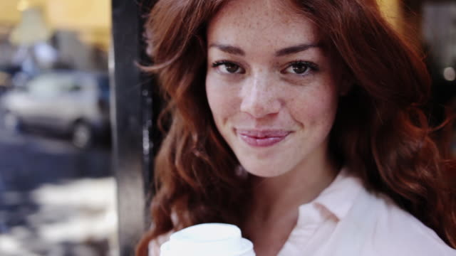 portrait of red-haired woman having a cup of coffee - redhead stock videos & royalty-free footage