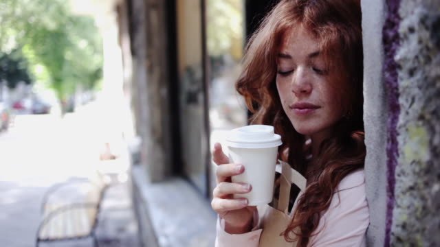 portrait of red-haired woman having a cup of coffee - bag stock videos & royalty-free footage