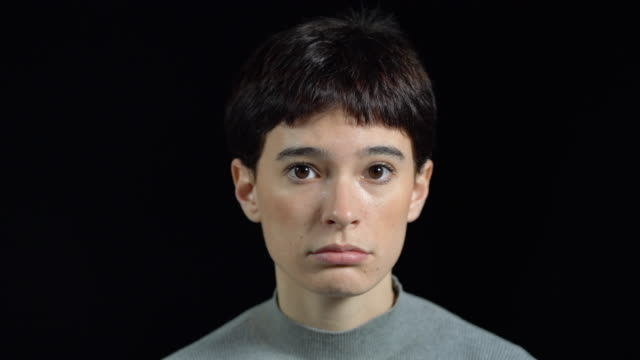 portrait of sad young woman with short brown hair - blank expression stock videos & royalty-free footage
