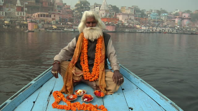 ws, portrait of sadhu sitting on boat in ganges river, varanasi, uttar pradesh, india - wide shot stock videos & royalty-free footage