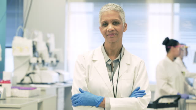 portrait of scientist in bio-medical laboratory - female doctor stock videos & royalty-free footage