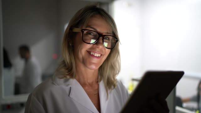 portrait of scientist using tablet in laboratory - microbiology stock videos & royalty-free footage