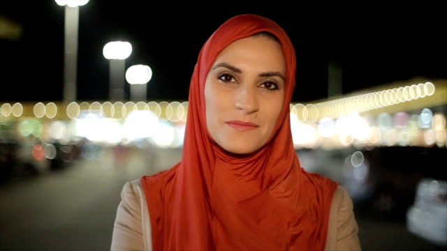 portrait of senior arab woman on the street  at night - saudi arabia stock videos & royalty-free footage