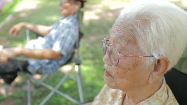 portrait of senior asian woman, slow motion - video portrait stock videos & royalty-free footage