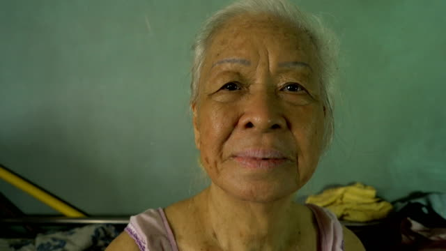 portrait of senior asian woman smile to camera. - 50 59 years stock videos and b-roll footage