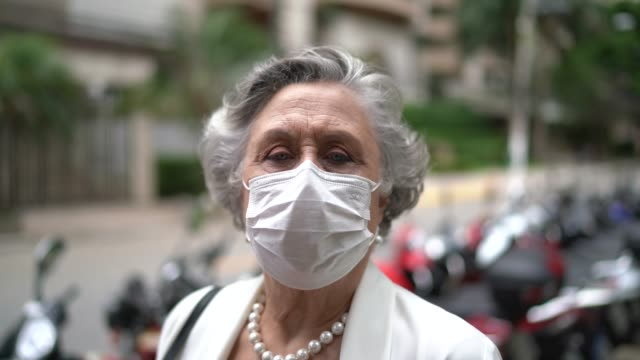 portrait of senior businesswoman with mask - protection stock videos & royalty-free footage