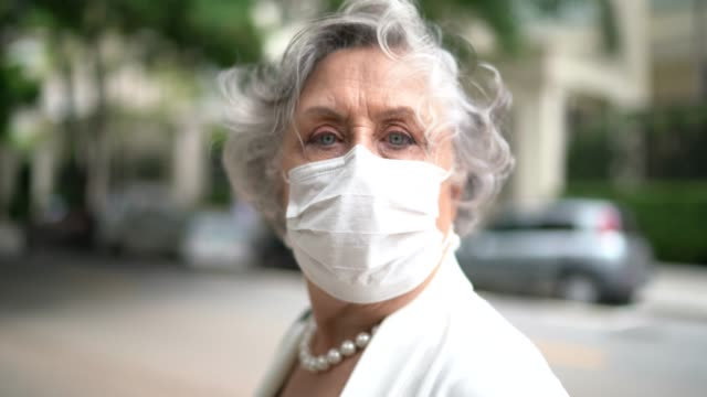 portrait of senior businesswoman with mask - respiratory system stock videos & royalty-free footage