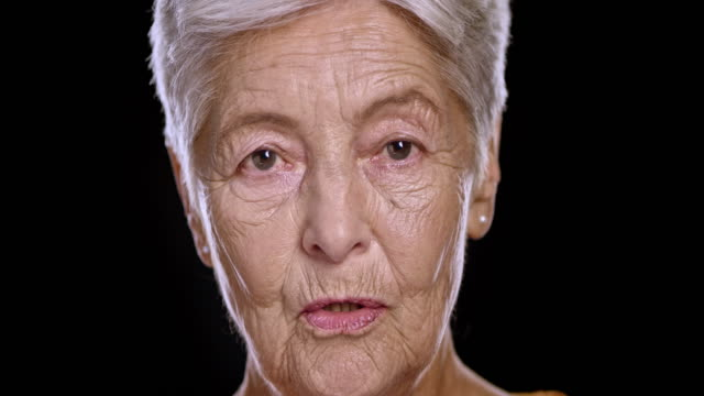 portrait of senior caucasian woman talking - one senior woman only stock videos and b-roll footage