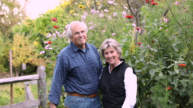 portrait of senior couple in flower garden - manchester vermont stock videos & royalty-free footage