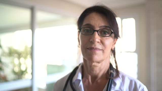 portrait of senior female doctor - female doctor stock videos & royalty-free footage