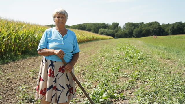 HD DOLLY: Portrait Of Senior Female Farmer