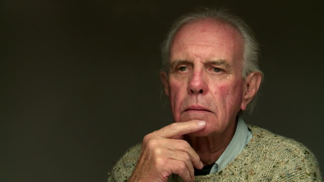 portrait of senior male thinking, - confusion stock videos and b-roll footage