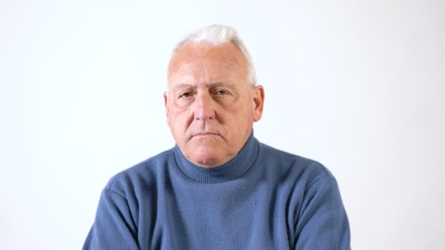 portrait of senior man against white background - one senior man only stock videos & royalty-free footage