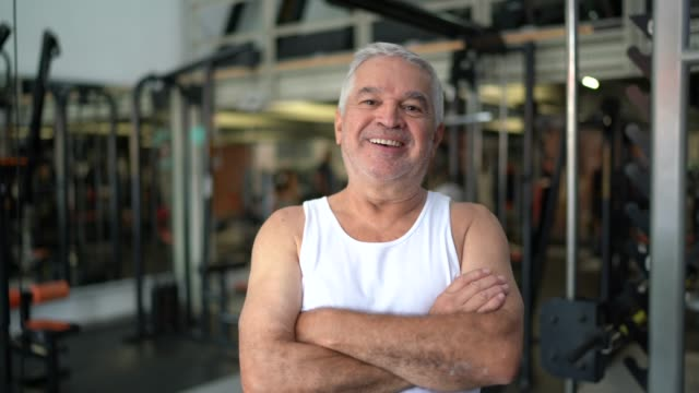 portrait of senior man exercising in gym - sportswear stock videos & royalty-free footage