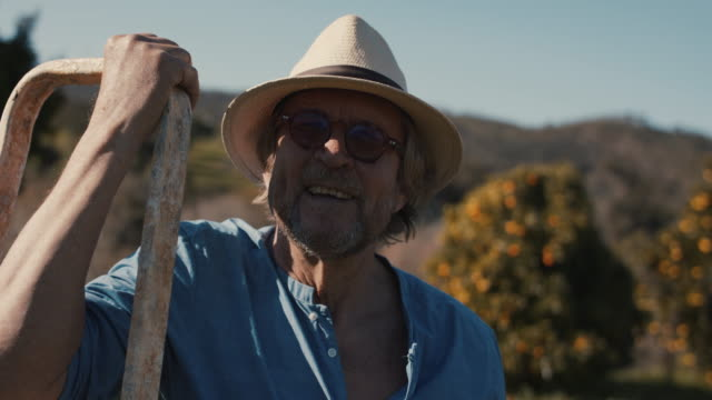 portrait of senior man in his organic garden - active seniors stock videos & royalty-free footage