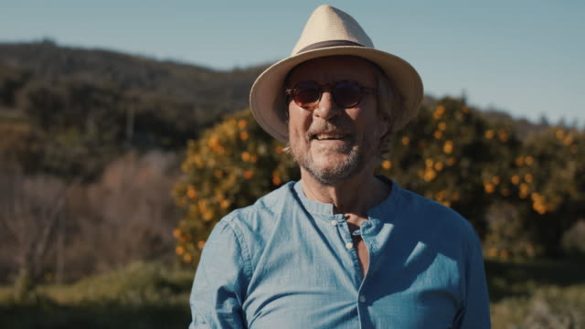 portrait of senior man in his organic garden - ladder stock videos & royalty-free footage