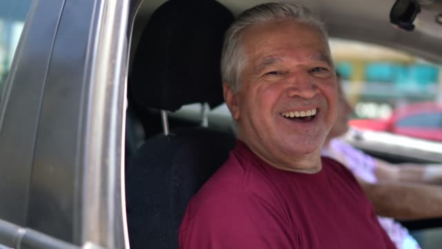 portrait of senior man inside a car - pardo brazilian stock videos & royalty-free footage